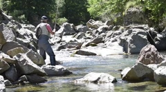Fisherman trout fishing with bait in mountain river Stock Footage