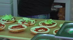 Chef prepares hamburger buns  Stock Footage
