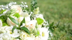 Bridal bouquet lying on green grass Stock Footage