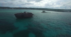 Aerial flyby of shipwreck towards shore Stock Footage