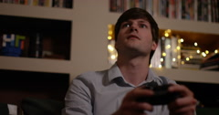 4k, Portrait of a young man playing video game after coming back home from work. Stock Footage