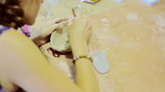Young woman sculpts pot from clay with enthusiasm Stock Footage