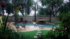 Establishing Shot of Residential Arizona Backyard Pool in a Haboob Stock Footage