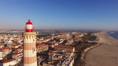 Lighthouse on the beach Praia Velha, Barra, Aveiro, Portugal aerial view Stock Footage
