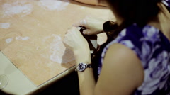Hands of young woman ceramist working with clay in workshop Stock Footage