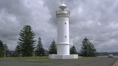 Australia clouds behind Kiama Harbour Light Stock Footage