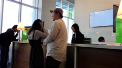 Attractive asian clerk helping customer to deposit money inside TD bank Stock Footage