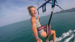Young Woman Flying While Parasailing with GoPro in Sky over Sea. 4K. - stock footage