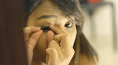 Young Thai Lady glues fake eyelashes 4k UHD (3840x2160) - stock footage