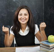 portrait of happy cute student in classroom at blackboard back to school having - stock photo