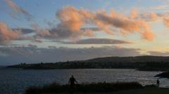 Australia Kiama sunset people walking by bay Stock Footage