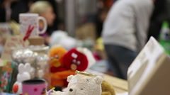 People selling handmade toys at trade fair, raising charity funds for sick kids Stock Footage