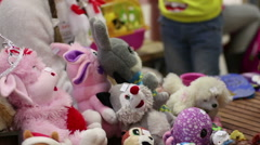 Kind-hearted volunteers collecting children's toys for charity aid to orphans Stock Footage