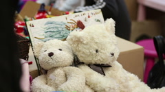 Nice teddy bears at toy shop, tender gift for child, romantic present on date Stock Footage