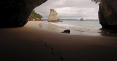 Aerial flying through cave at Cathedral Cove,  New Zealand Stock Footage