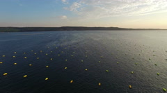 4K. Flight over fishing place with floats at sunset in the sea, aerial. Stock Footage