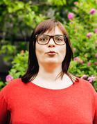pretty modern mature fat woman outside wearing glasses, emotional posing happy - stock photo