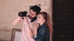 Young tourists using DSLR on vacation Stock Footage