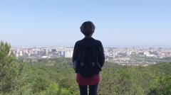 Girl in old abandoned building with city Landscape view - Lisbon Stock Footage