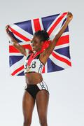 Female Athlete Holding a British Flag Stock Photos