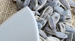 A close up of rotating Sunflower seeds Stock Footage