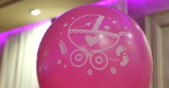 Pink baloon with draw pram Stock Footage