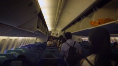 airplane cabin with passengers sitting and save the luggage. Inside airplane-Dan - stock footage