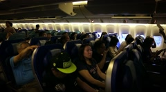 airplane cabin with passengers sitting and waiting the plane take off-Dan - stock footage