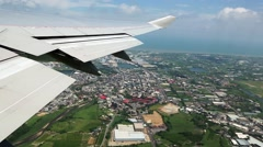Aerial view of the taiwan city from airplane window, Traveling by air. -Dan Stock Footage