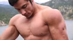 Bodybuilder flexing outdoors Stock Footage