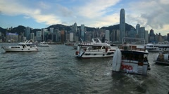 Ferry in Hong Kong bay with the cityscape background, view from Kowloon Bay-Dan Stock Footage