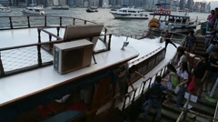 Tourists take the boat in Kowloon Bay in a Ferry at Hong Kong harbor-Dan Stock Footage