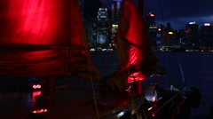 Junk Ship with the Red sail In Front Of Hong Kong Skyline At Night -Dan Stock Footage