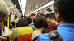 Passengers at rush hour are standing in the metro of Kowloon, Hong Kong-Dan Stock Footage