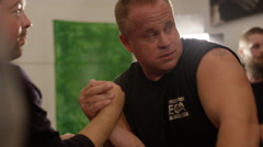 Professional arm wrestling practice in an athlete's garage Stock Footage