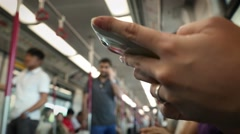 Woman Using Smartphone In Subway sits down to do some quick text messaging-Dan Stock Footage