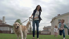 Walking with Family Pet Stock Footage