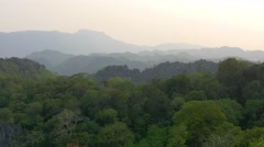 Sunset view, landscape, mountains, jungle, Laos. Telephoto lens, long shot, 4K Stock Footage