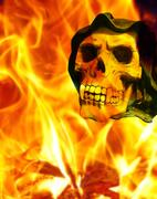 Horror skull with canine teeth on fire background Stock Illustration