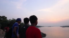 Young men look out over the Ganges River - stock footage