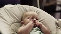 Adorable little girl sway on swing in apartment. Baby dummy. Child. Relax Stock Footage