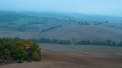 Dense Morning Fog in the Hills of Tuscany. Time Lapse 4K Stock Footage