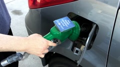 Finish filling up car gas tank at Husky gas station Stock Footage