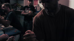 Professional arm wrestling practice in an athlete's garage - stock footage