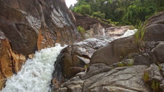 Stormy Stream Cascade in Rocky Canyon Falls into Pool Stock Footage