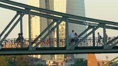4K Skyline of ECB EZB Frankfurt am Main Eisener Steg metal bridge dusk Germany Stock Footage