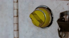 A close up shot of a hand turning a yellow control knob once and letting go. Stock Footage