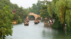 Wuzhen China canals barges & bridge Stock Footage