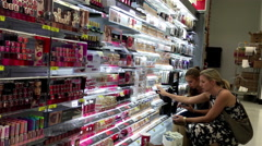People looking beauty products in Walmart store Stock Footage