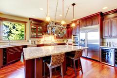 Luxury modern kitchen room with mahogany storage combination, granite tops, i Stock Photos